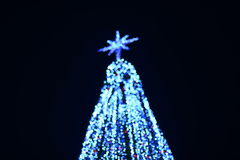 Blue bokeh abstract light christmas tree Royalty Free Stock Photo