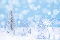 Blue bokeh background of silver christmas tree Stock Photo
