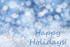 Blue Bokeh Christmas Background, Snow, Text Happy Holidays Stock Photography