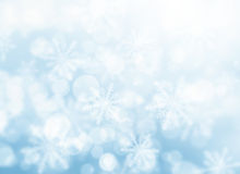 Blue bokeh snowflakes Stock Photo