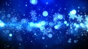 Blue bokeh and snowflakes lights on blue background with Christmas theme Royalty Free Stock Photos