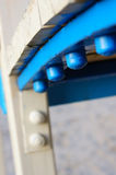 Blue bolts. Close up of a row of blue bolts Royalty Free Stock Image