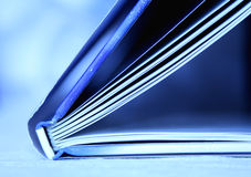 Blue Book. Spine of a blue book with the pages open royalty free stock image