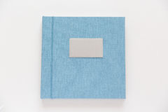 Blue book with fabric cover Stock Images