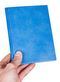 Blue book in hand Royalty Free Stock Photos