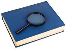 Blue book and magnifying glass Stock Photography