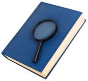 Blue book and magnifying glass Royalty Free Stock Image