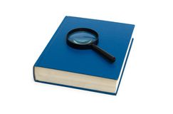 Blue book and magnifying glass. On the white Royalty Free Stock Images