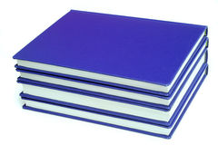 Blue books. Stack of blank blue books - university graduate theses - over white Royalty Free Stock Photo