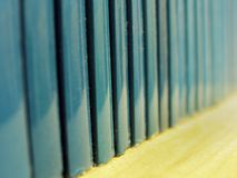 Blue Books. A line of blue books on a shelf, closeup with very shallow focus Royalty Free Stock Photos
