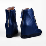 Blue boots Stock Images