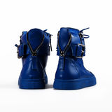Blue boots over white Royalty Free Stock Photo