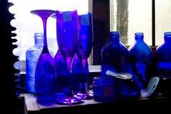 Blue Bottle. Blue glass bottles on a window ledge Royalty Free Stock Image