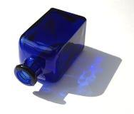 Blue Bottle. Blue glass bottle, naturally lit Stock Photo