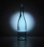 Blue Bottle. A back-lit light blue tinted bottle Royalty Free Stock Image