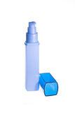 Blue bottle with a dispenser. Blue bottle for cosmetics on a white background Stock Photography