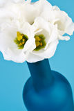 Blue bottle with flowers Royalty Free Stock Photos