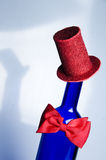 Blue bottle with Hat and bow tie Stock Photo