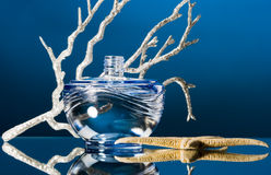 Blue bottle of perfume Stock Photo