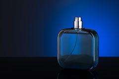 Blue bottle of perfume Stock Image
