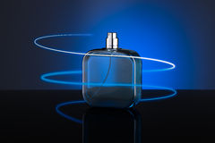 Blue bottle of perfume Royalty Free Stock Photography