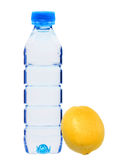 Blue bottle with water and fresh yellow lemon isolated on white Royalty Free Stock Photography
