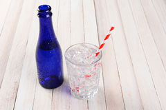 Blue Bottle Water Glass Ice Straw Stock Photography