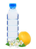 Blue bottle with water, jasmine flowers and fresh yellow lemon i Royalty Free Stock Photos