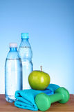 Blue bottle of water and sport stuff Royalty Free Stock Image