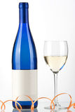 Blue bottle of white wine and wine glass. Isolated on white background Stock Photos
