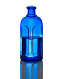 Blue Bottle wih water. Blue Antique Bottle with water Stock Photo