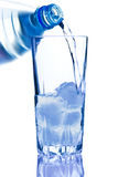 Blue Bottled. With Water And Glass With Ice stock photo