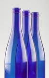 Blue bottles. Three empty blue bottles isolated on white (close up Royalty Free Stock Photo