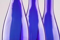 Blue bottles. Three empty blue bottles isolated on white (close up Stock Image