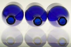 Blue bottles. Three empty blue bottles isolated on white (close up Stock Photo