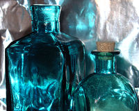 Blue Bottles. Two blue glass bottles one with a cork stopper Royalty Free Stock Photos