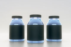 Blue bottles with black labels Stock Photo