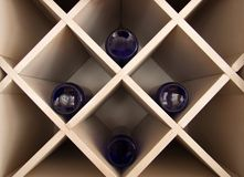 Blue bottles in the cupboard. Blue bottles laying in the vintage cupboard royalty free stock photos