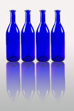 Blue bottles with reflection isolated on white background Stock Photos