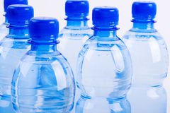 Blue bottles of water Royalty Free Stock Images
