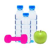 Blue bottles with water, dumbell and green apple Stock Photo