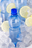 Blue bottles of water in ice Royalty Free Stock Images