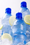 Blue bottles of water in ice Royalty Free Stock Photography