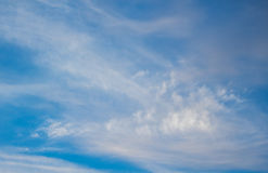 Blue boundless sky with the fluffy clouds Stock Photography