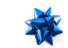 Blue bow. A blue Christmas bow over white royalty free stock photos