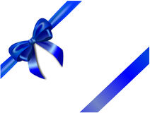 Blue bow. Blue silk bow and ribbon isolated on the white background Royalty Free Stock Photo