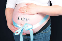 Blue bow around pregnant woman Royalty Free Stock Images