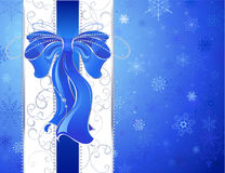Blue bow on a blue background Royalty Free Stock Photos