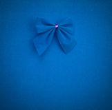 Blue bow on a blue background with vignette. mock up for text, congratulations, phrases. Lettering Royalty Free Stock Photography