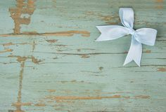Blue bow in the corner of the grunge background royalty free stock images